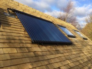 Solar THermal evacuated tubes fitted on Earthworks community headquarters in St Albans