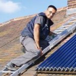 Jay installing Solar Panels on a roof in St Albans